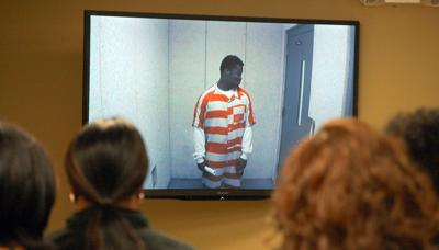 Suspect in gas station slaying curses, walks out of hearing