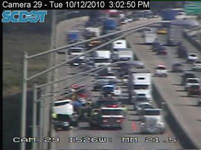 Tractor-trailer wreck slowing traffic on Don Holt Bridge