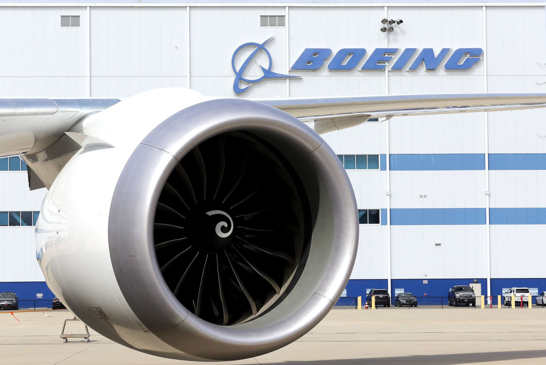 Boeing beats 2Q profit forecasts as its shares continue to rise