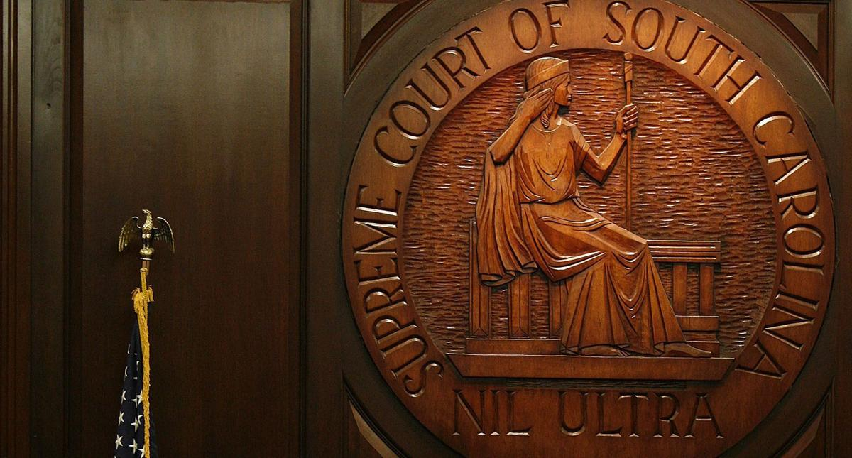 Justices won't reconsider education ruling