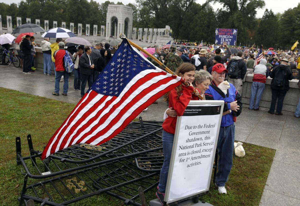 Crowd pushes through barriers at World War II Memorial to protest government shutdown