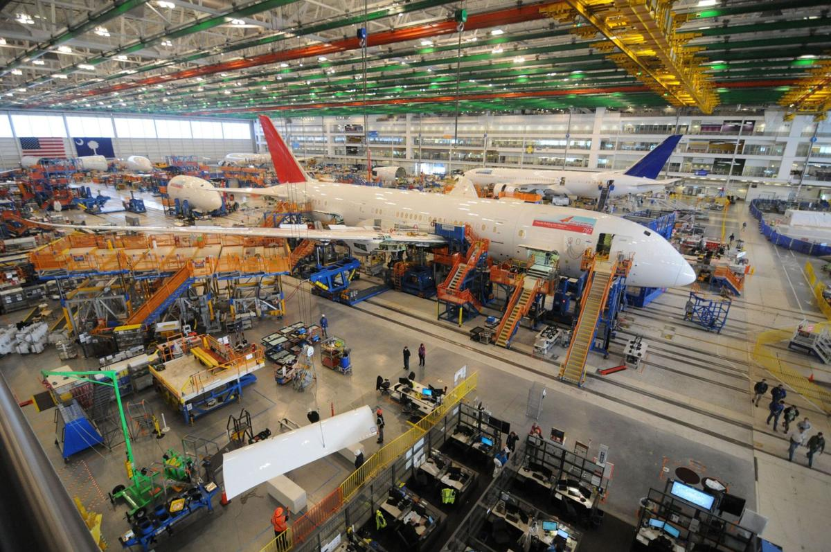 Boeing airplane division to trim jobs