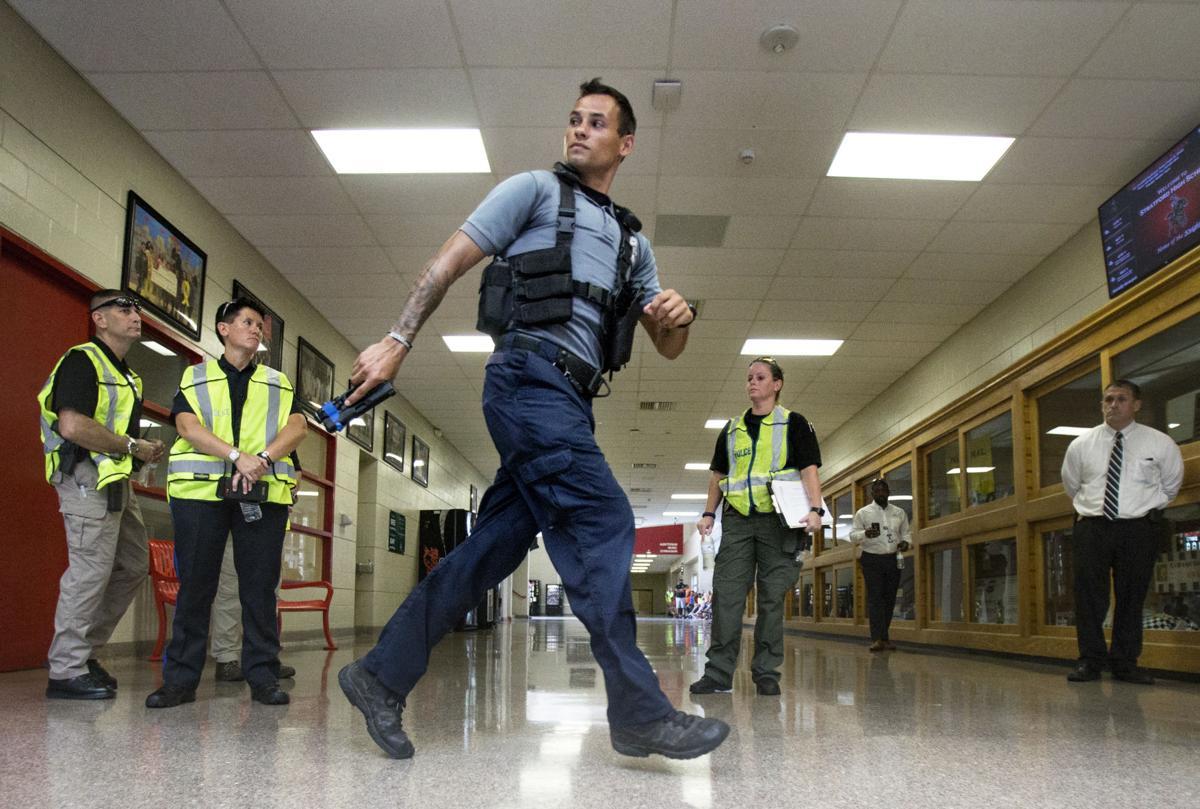 LEDE officerrunningdownhall gm.jpg