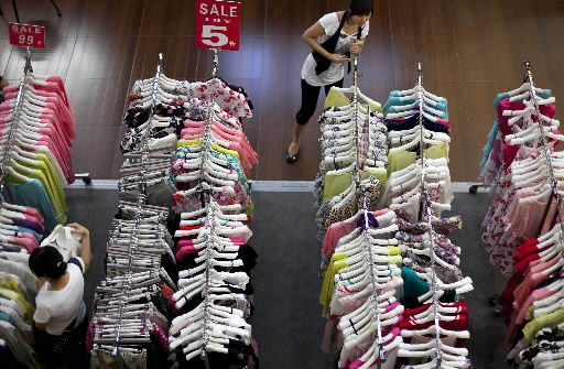 China's hot economy surges 10.3 percent in 2010