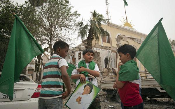Gadhafi's son killed, leader survives NATO missile strike
