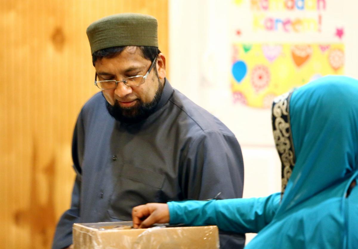 breaking fast with dates mosque ramadan.jpg