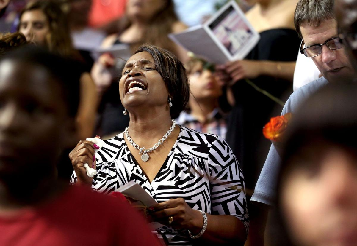 Thousands unite at prayer vigil to heal in wake of shooting that killed 9 at Emanuel AME
