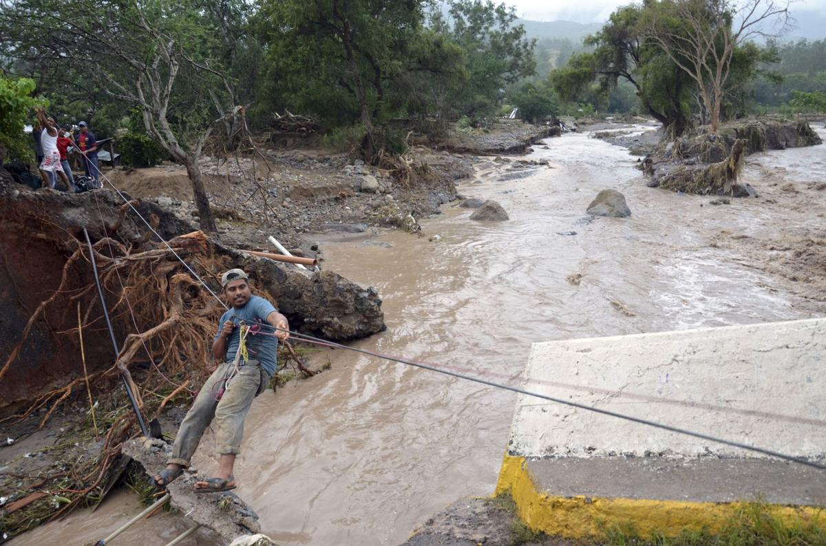 Mexico mudslide victims recount horror; toll rises to 97