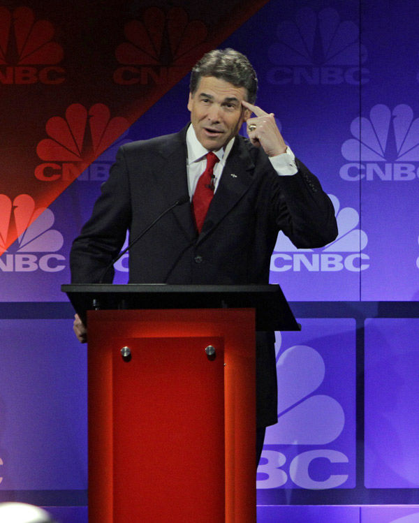 Perry owns up to debate blunder, presses on