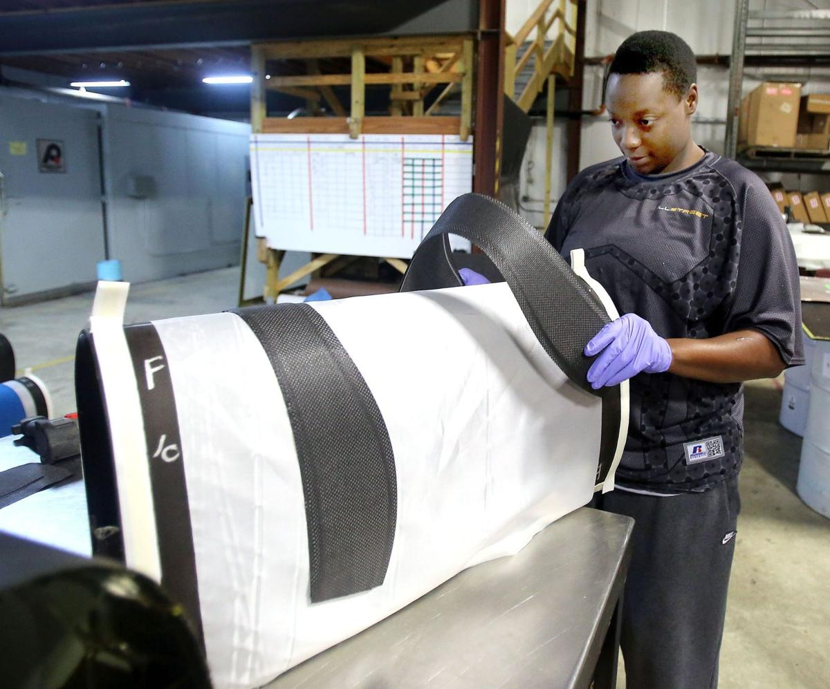 Charleston manufacturer uses Boeing scrap for football pads