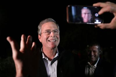 Bush sticks with basics but steps up enthusiasm for campaign