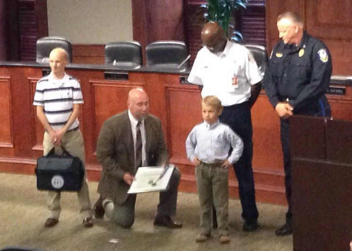 Young boy honored after 911 call