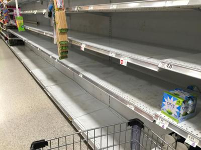 Empty grocery shelves bottled water storm