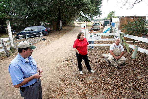 Families settle farm road suit
