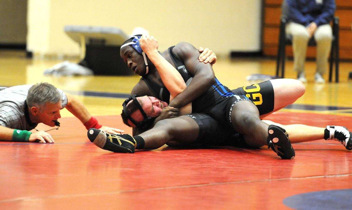 Patriots' Alford finally wins wrestling gold
