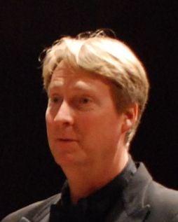 Director to strike up band at bowl