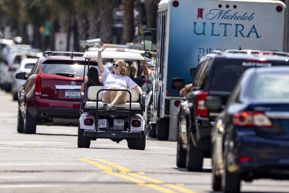 LEDE forpc-051221-ne-golfcarts  golf cart king street.jpg