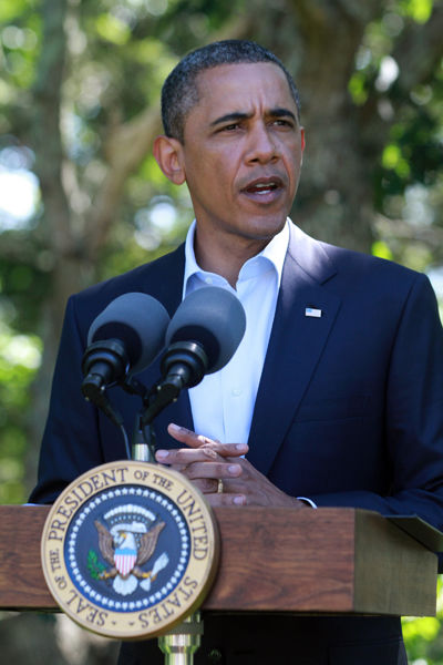 Rebels hold Tripoli as Obama calls for peaceful transition