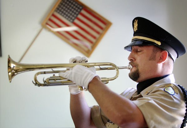Honor and respect: Buglers who play taps at veterans' funerals know there's no room for error