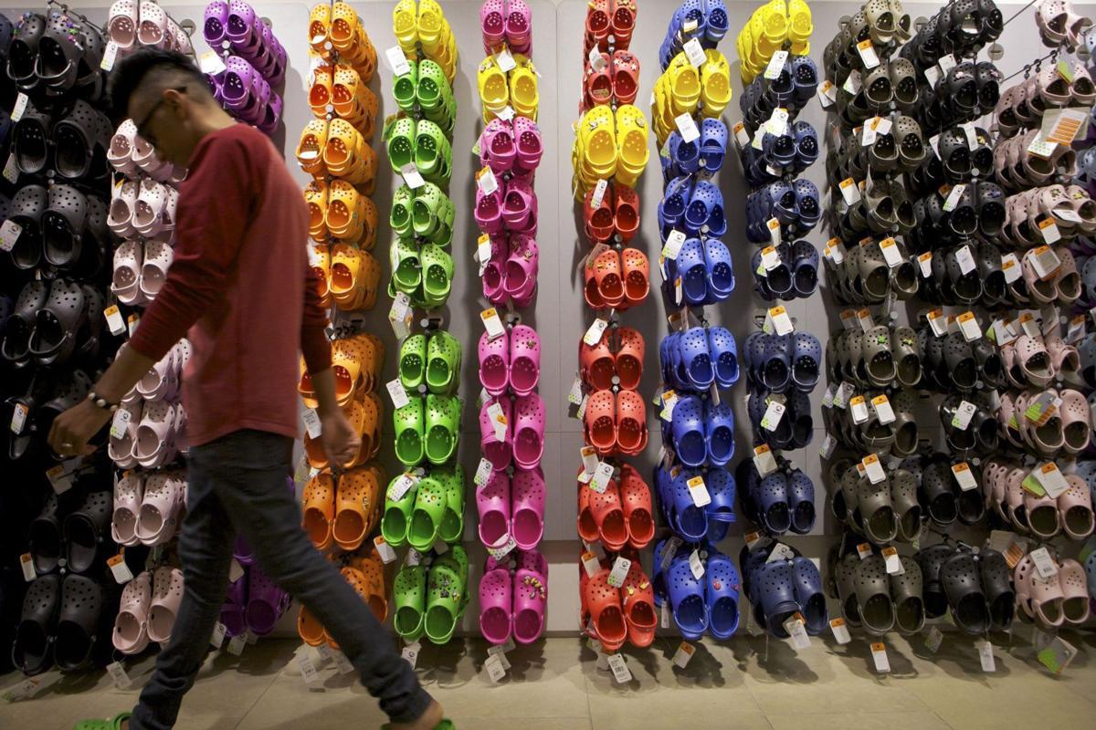 Crocs CEO leaving as Blackstone invests $200M in footwear marker