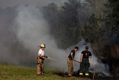 Local firefighters battling brush and woods fires as authorities warn against outdoor burning