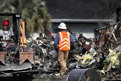 Asbestos slows demolition of Sofa Super Store