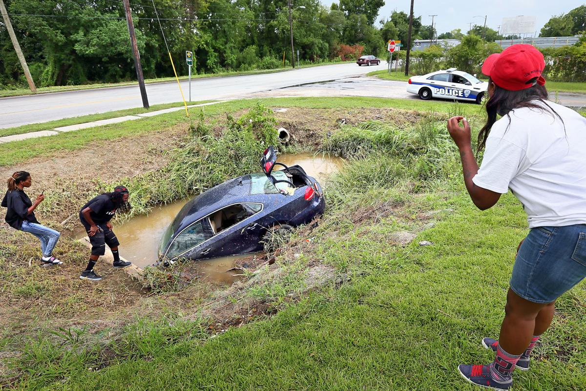car in ditch nchas flooding.jpg