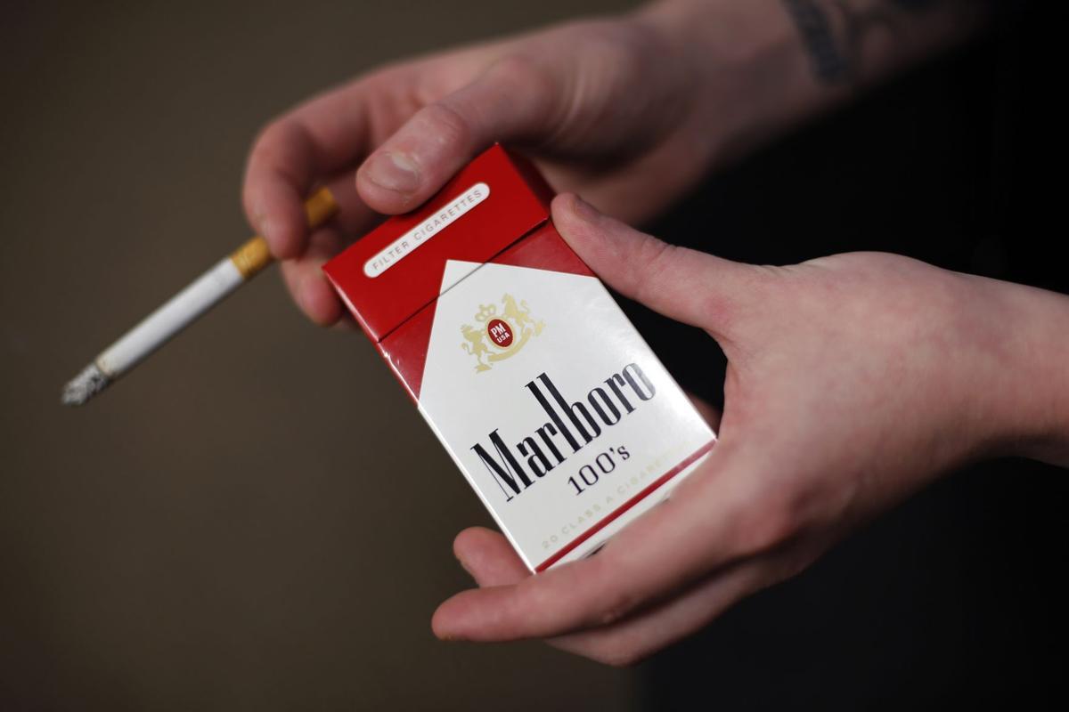 Better economy spurs Altria cigarette sales