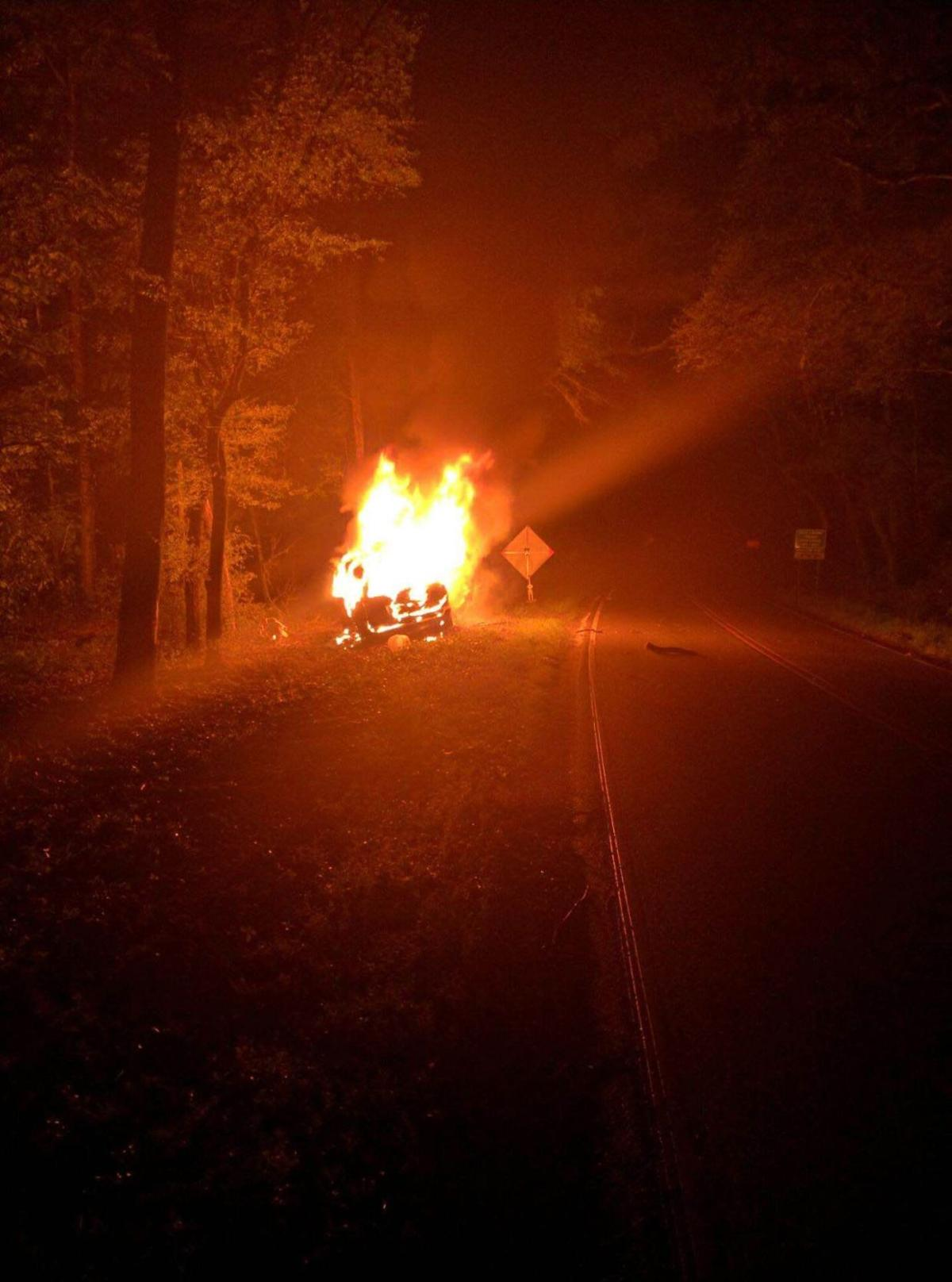 Coast Guardsman, others save driver from fiery wreck