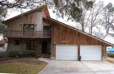 1817 Fishing Lane — Contemporary home on Cooper River's west branch boasts boat dock, pool, interior accents