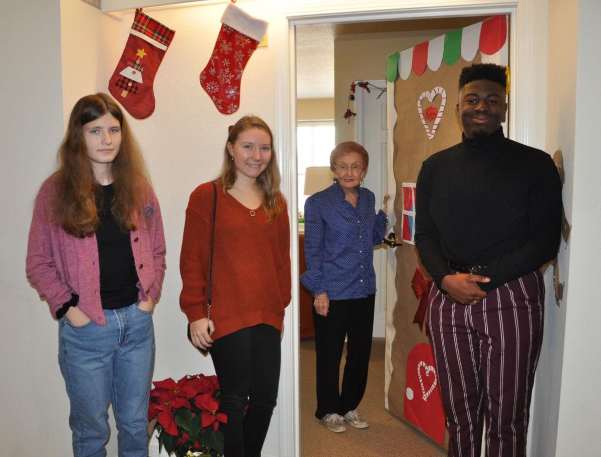 Aiken High Interact members celebrate Christmas with Hitchcock Place residents 1