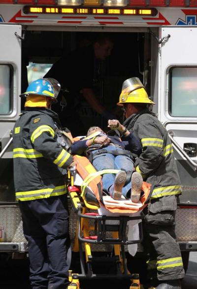 1 dead, 13 hurt in collapse of Philly building