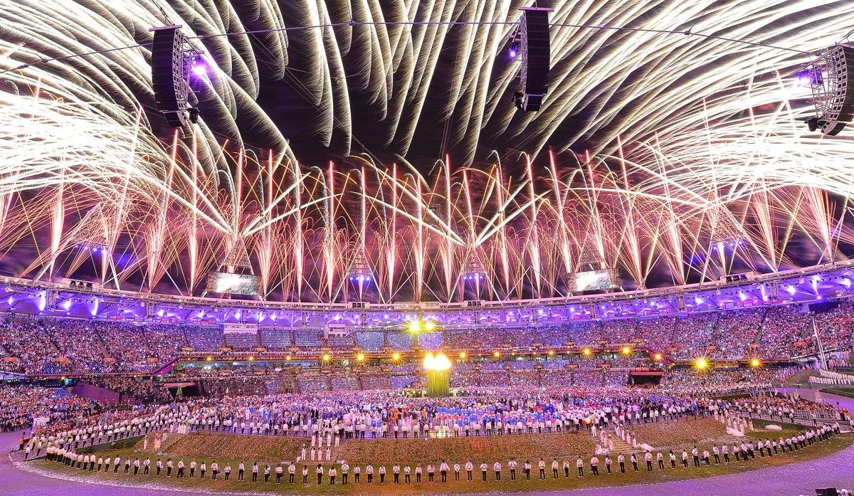Rock and royal Olympics open in London with Queen Elizabeth II on hand