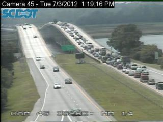 Westbound lanes of I-526 backed up after dump truck loses load on Westmoreland Bridge