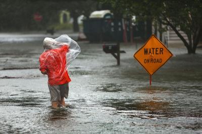 PRINT TUESDAY wading storm hurricane irma.jpg (copy) (copy)