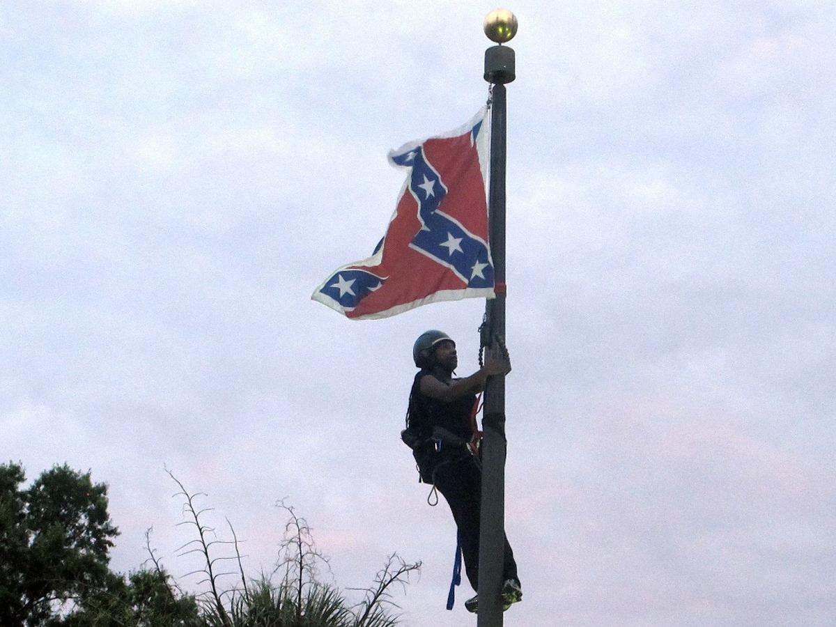 Woman takes down Confederate flag on Statehouse grounds
