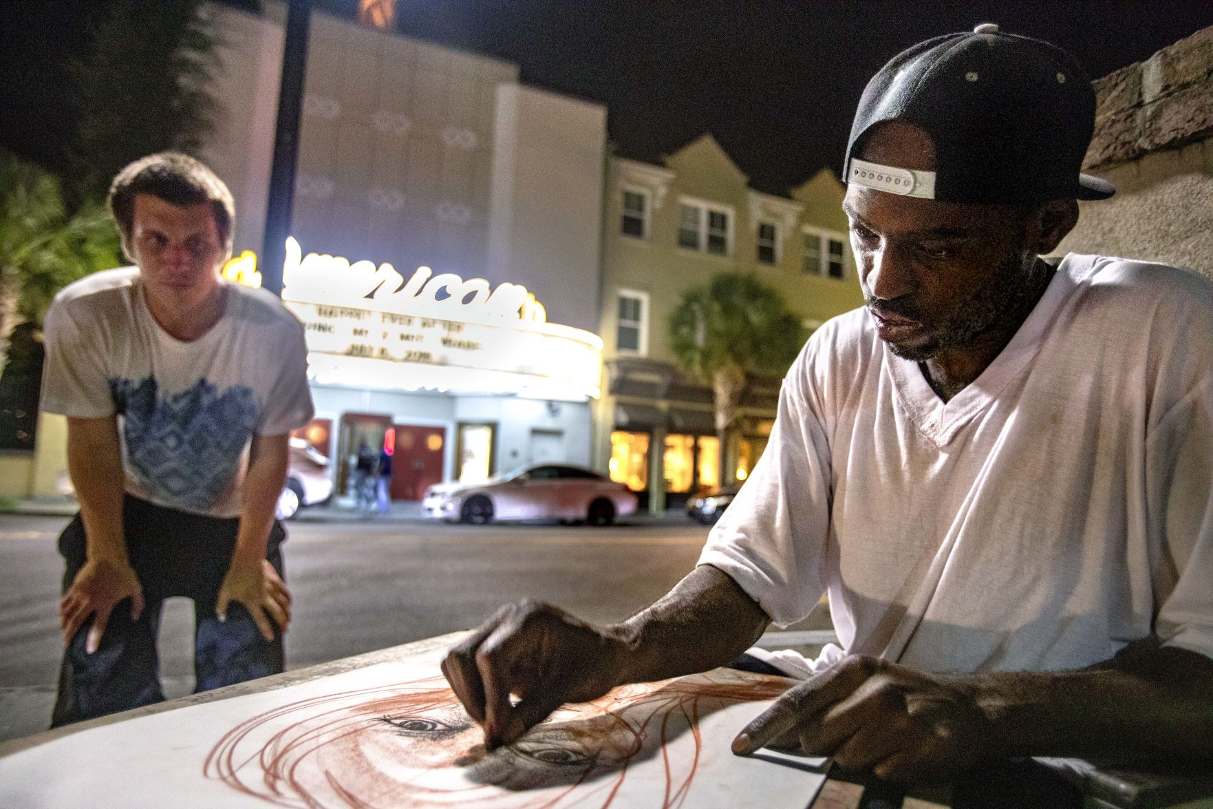 Formerly homeless artist provides for his family selling portraits in Charleston | Post and Courier