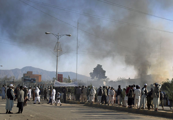 Afghan protesters kill 7 foreigners