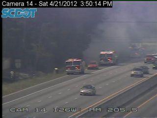 Traffic on Interstate 26 slowed by heavy smoke as crews battle woods fire