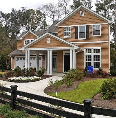 Traditional, sturdy-framed houses from Ryland Homes sprout in lower Dorchester County
