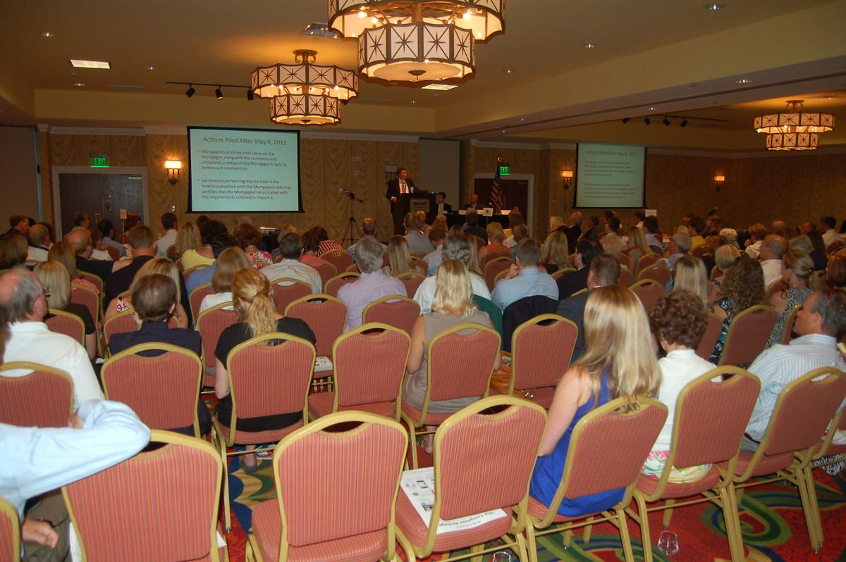 Local Realtors query panelists about foreclosures, mortgage lending policies at housing update