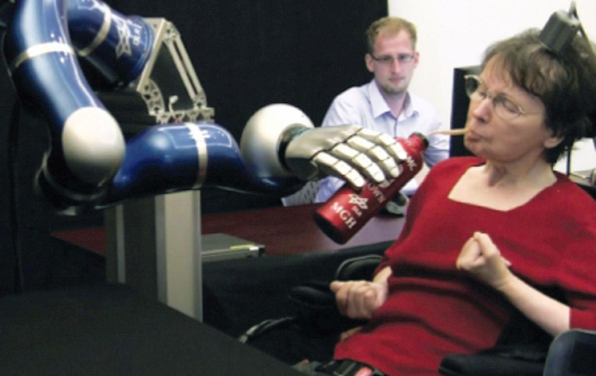 Woman's thoughts direct robot arm