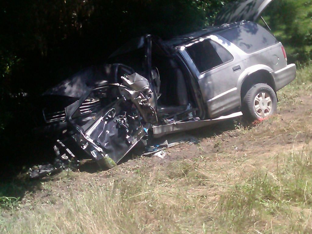 Woman dies, 4 injured after SUV hits tractor on Interstate 26