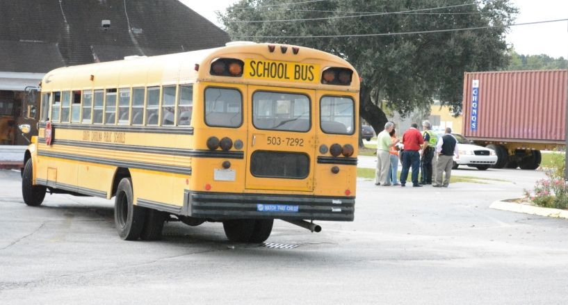 Moped crashes into back of Charleston County school bus on Rivers Avenue