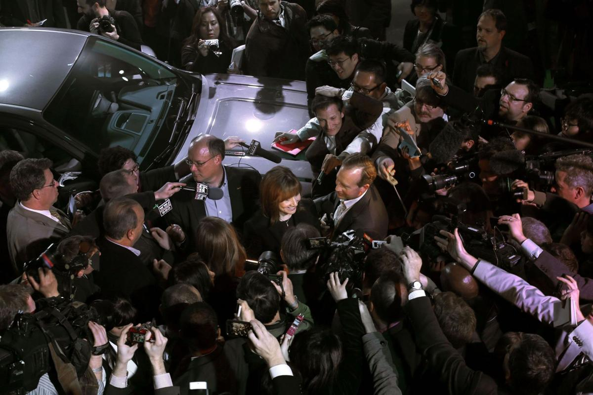 Media throng trips over itself chasing down new GM CEO at auto show
