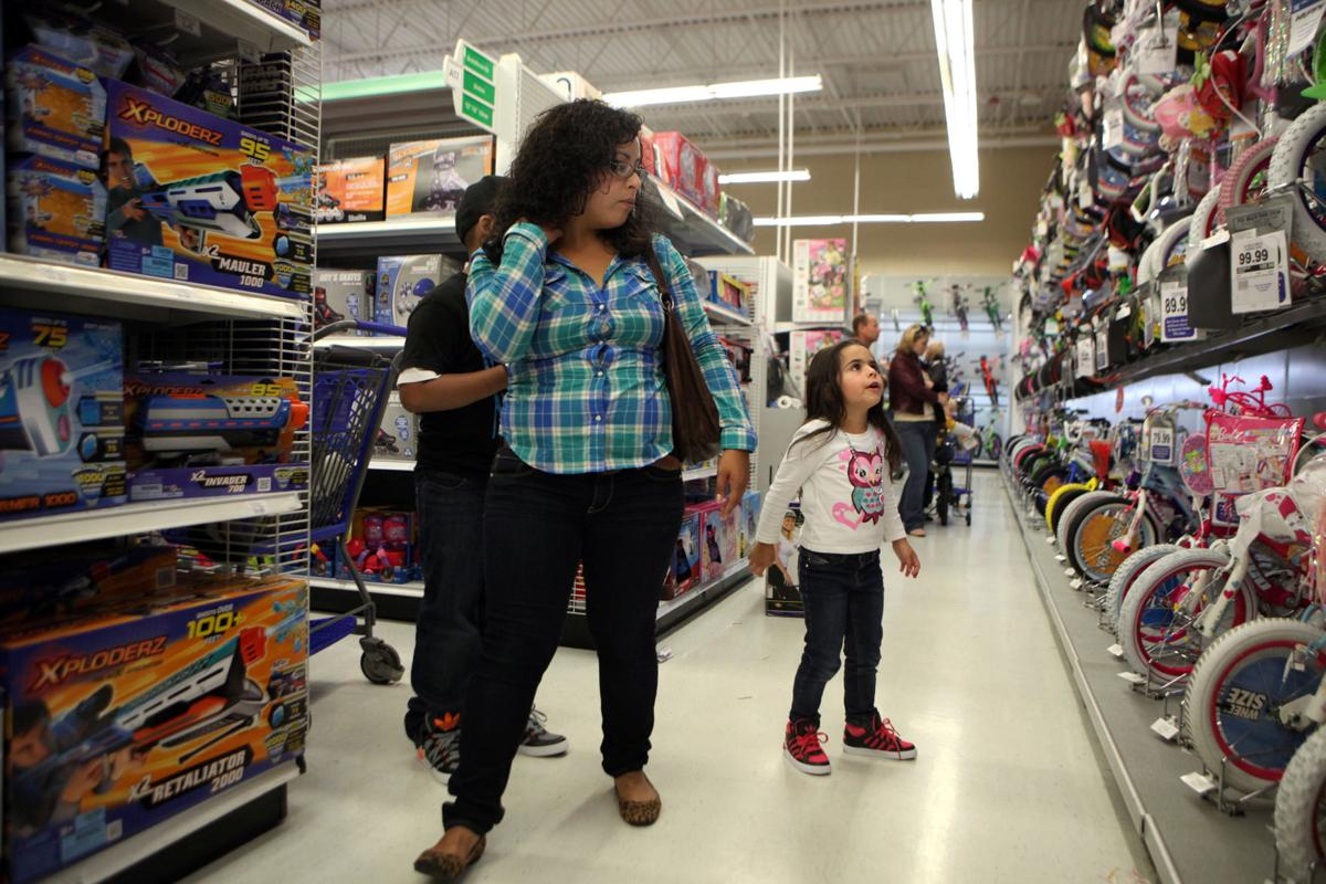 Retailers race for the holidays Christmas layaways, decor already in place to lure shoppers into buying early, often