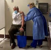 Dr. David Cole, president of MUSC, gets his first shot in a COVID vaccine trail (copy)