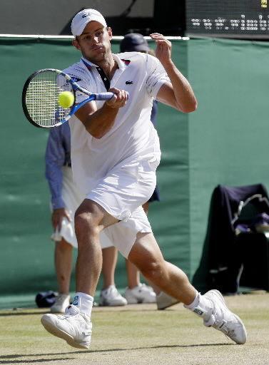 Roddick, Henin ousted; Williamses, Nadal roll
