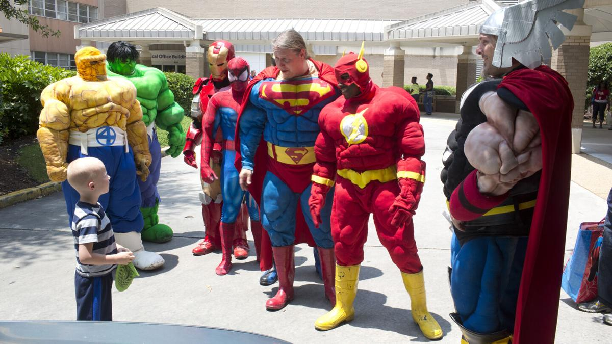 Cancer Patient  and Superheroes in parking lot_small[760].jpg