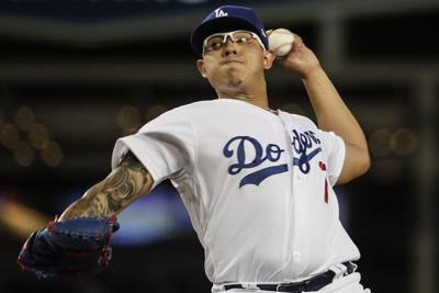 Dodgers' Urias accused of domestic battery